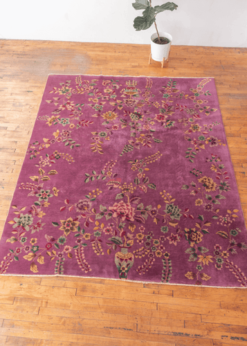 Chinese deco rug with purple field and large scale curvilinear floral motifs in excellent condition with no signs of wear