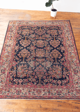 Image of mid century Turkish Sparta rug with dark indigo field and all-over psychadelic floral design