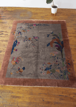 Chinese Deco rug with salmon border and silvery gray field with rooster motif on the lower left corner, banana tree and floral motifs on the right corner and more floral motif throughout. In excellent condition, with no signs fo wear