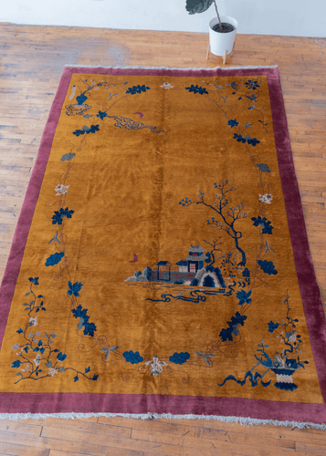 Chinese Deco rug with golden yellow field and pink border. Minimal and elegant floral design in blues and whites. in excellent condition