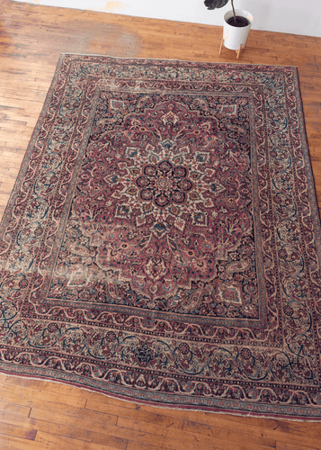 Late 19th century Doroksh E Persian rug with complex curvilinear floral motif on a scalloped medallion design. Signed by weaver. In very good condition