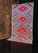 Kowli rag kilim handwoven during 21st century in Northwest Iran. Four large diamonds striped in a multitude of bright vibrating colors.
