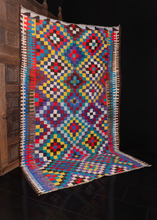 Contemporary Persian kilim in bright colors arranged in a small diamond pattern