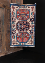 Ardabil rug handwoven in third quarter of 20th century in Northwest Iran. Soft ivory field with animal figures and geometric design in red, green and blue. Black central medallion.