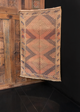 Baluch rug handwoven in Western Afghanistan during second quarter of 20th century. Soft palette of pinks, purples and browns in a diamond hook pattern characteristic of the Mashwani tribe.