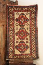 Kurdish Bidjar wool rug handwoven in early 20th century. Graphic triple medallion design with cream ground. Red, brown, and blue decorative elements.