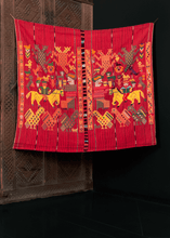 Textile crafted on a backstrap loom near Nahuala, Guatemala during 20th century. Called a tzute meaning a multifunctional cloth used to wrap or carry things on a person's head. Interesting design of shapes, animals and figures.