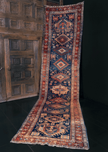 Karadagh runner handwoven in Northwest Iran during second quarter of 20th century. Series of graphic medallions in blue, brown, tan and pops of hot pink.