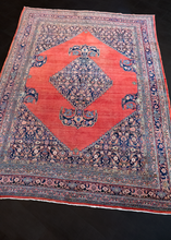 Bidjar rug handwoven second quarter of 20th century in Western Iran. Open red field, soft brash, central medallion with a Herati design on an indigo field.