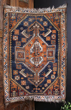 Afshar rug handwoven in Southwest Persia during the first quarter of the 20th century. Beautiful indigo blues and burnt orange in a geometric design with small asymmetries.