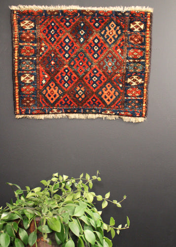 Bag face woven by the Jaff Kurds of the Northern and Central Zagros mountains. Classic geometric diamond pattern with bright colors.