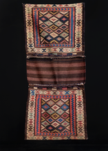 "Double saddlebag or ""Khorjin"" was handwoven by Kurds during second quarter of 20th century. Closure is composed of brown, red and white slit tapestry with blue and purple braided loops. Classic Jaff patterning of multicolored diamonds."