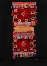 "Double saddlebag or ""Khorjin"" handwoven in Afghanistan during third quarter of 20th century. Bag face features a red, white and brown geometric design with a border of animals and stars."