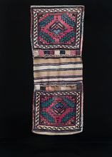 "Veramin double saddlebag or ""Khorjin"" woven during third quarter of 20th century in Iran. Stylized boteh surrounded by four serrated leaves. Blues, greens and purple."