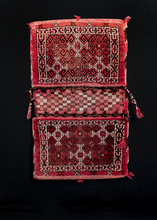 "Turkmen double saddlebag or ""Khorjin"" woven during second quarter of 20th century. Repeating geometric motif with large border. Red, white and brown."
