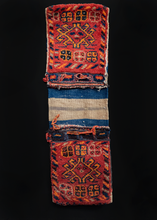 Saddlebag from Western Iran handwoven during third quarter of 20th century. Hand drawn geometric design with a slight border of diagonal stripes. Browns, oranges and reds with indigo blue details.