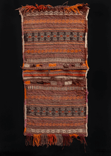 "Kilim woven double saddlebag or ""Khorjin"" woven in Afghanistan during second quarter of 20th century. Closure is composed of brown, purple and orange slit tapestry. Bag face design is multicolored stripes in brown and purple with geometric patterns within."