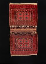"Double saddlebag or ""Khorjin"" handwoven by Turkmen during first quarter of 20th century. Braided loops at tops of both bag faces. Four guls in the center. Reds, browns, blues and yellows/ivories."