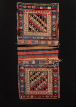 "Double saddlebag or ""khorjin"" made by Kurds in Northwest Iran during the first quarter of the 20th century. Low pile with a flat woven back in a multicolor striped pattern."