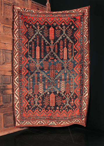 Lori rug handwoven in Southern Iran during the early 20th century. Deep blue field with a beautiful brash. Latticed panels with cypress trees make up the central design.