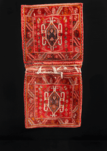 "Double saddlebag or ""Khorjin"" handwoven by the Qashqai in South Iran during middle of 20th century. Central design features a scarab motif on a red field filled with small geometric shapes and rosettes."