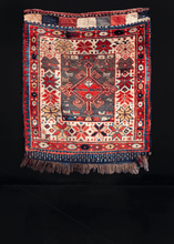 Qashqa'i bag face handwoven during first quarter of 20th century in South Iran. Red central medallion on faded grey-green field with various animals and protection symbols.