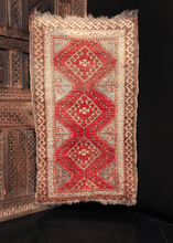 Yastik handwoven during second quarter of 20th century in Turkey. Three hooked diamonds form central design in bold red and a soft blue.