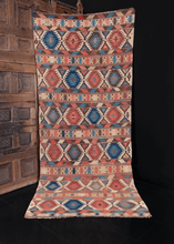 Colorful Shirvan kilim handwoven end of 19th century in Eastern Caucasus. Striped pattern of bold geometric shapes in blues, peaches, reds and tans.