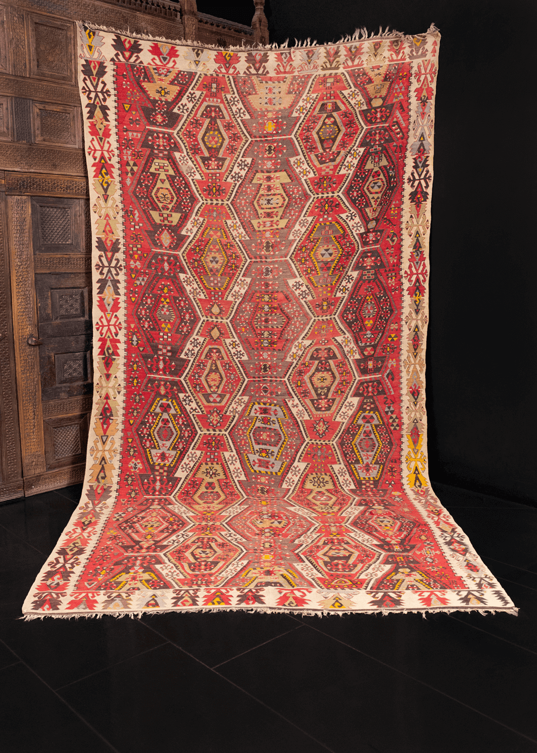 Reyhanli kilim handwoven in Southeast Turkey during second quarter of 20th century. Constructed in two parts and joined in the middle. Abstract geometric pattern in red, brown, blue and yellow.