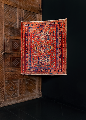 small karadja rug from the early 20th century featuring a three medallion design in reds, blues, and browns. Excellent condition