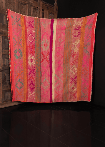 Contemporary Guatemalan blanket in multicolor stripes with geometric design on top, with crocheted edges in scalloped pattern