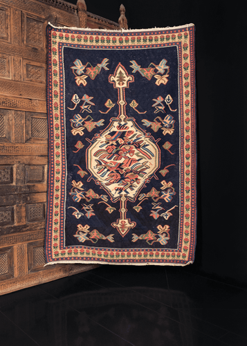 Bidjar kilim handwoven in Northwest Iran during middle of 20th century. Ivory abstracted rosette central medallion atop a navy field.