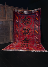 1968 Uzbeki rug with date woven into design of four eight pointed stars on deep red field with latchhooks and diagonal diamond main border. In excellent condition