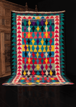 Persian vintage kilim with a colorful geometric pattern of stepped crosses on a striped background