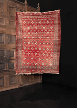 traditional turkmen rug in soft reds browns and ivories with abrash throughout