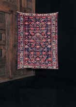 Hamadan rug with a deep blue indigo field and traditional leaf and blossom design, in bright red and soft ivory