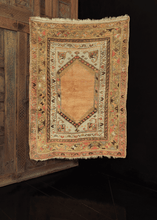 Turkish rug with plain central medallion and multiple borders in peach and gold tones