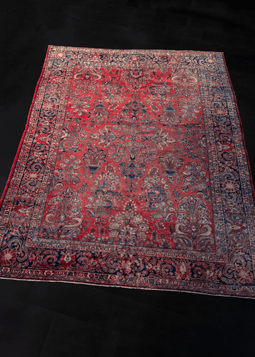 Image of Persian Sarouk rug featuring floral sprays allover a raspberry red field.