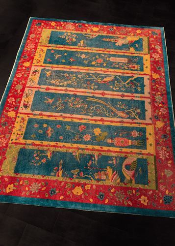 chinese deco rug with six screens with floral designs on a cobalt blue and magenta ground