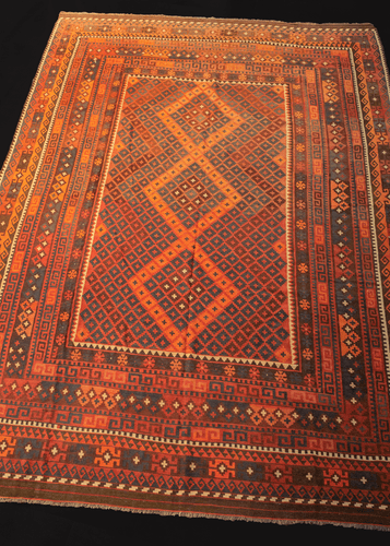 mid century maimana kilim with concentric diamond design in blue, red, and brown color palette