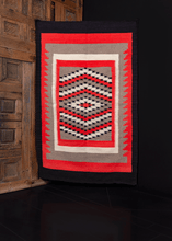 geometric SW USA navajo rug from the 19760s/70s, with bright red, grey, white, and black colors