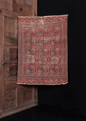 small Turkmen rug with allover gul design in red blue and ivory colorway