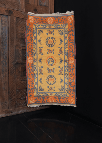 Vintage yellow & orange Chinese Gansu rug with gentle soft handle.