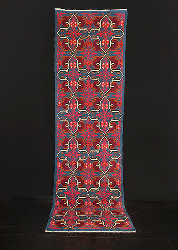 Moroccan Rabat runner handwoven during third quarter of 20th century. Geometric design in hot pink, ivory and purple on a turquoise field.