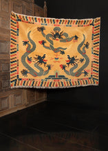 Ninghxia rug handwoven in China during first quarter of 20th century. Pictoral design of three dragons circling a pearl. Golden yellow, indigo blues, peaches, and brown.