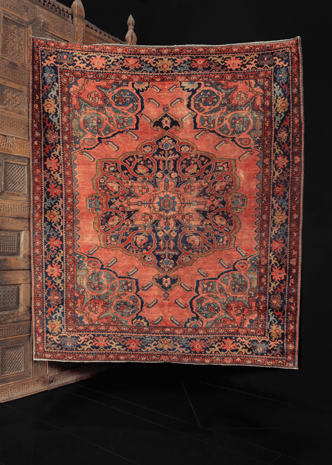 early 20th century lilihan rug from w iran with large central and cornices, with elaborate and unusual borders in peaches, indigo blues, and reds