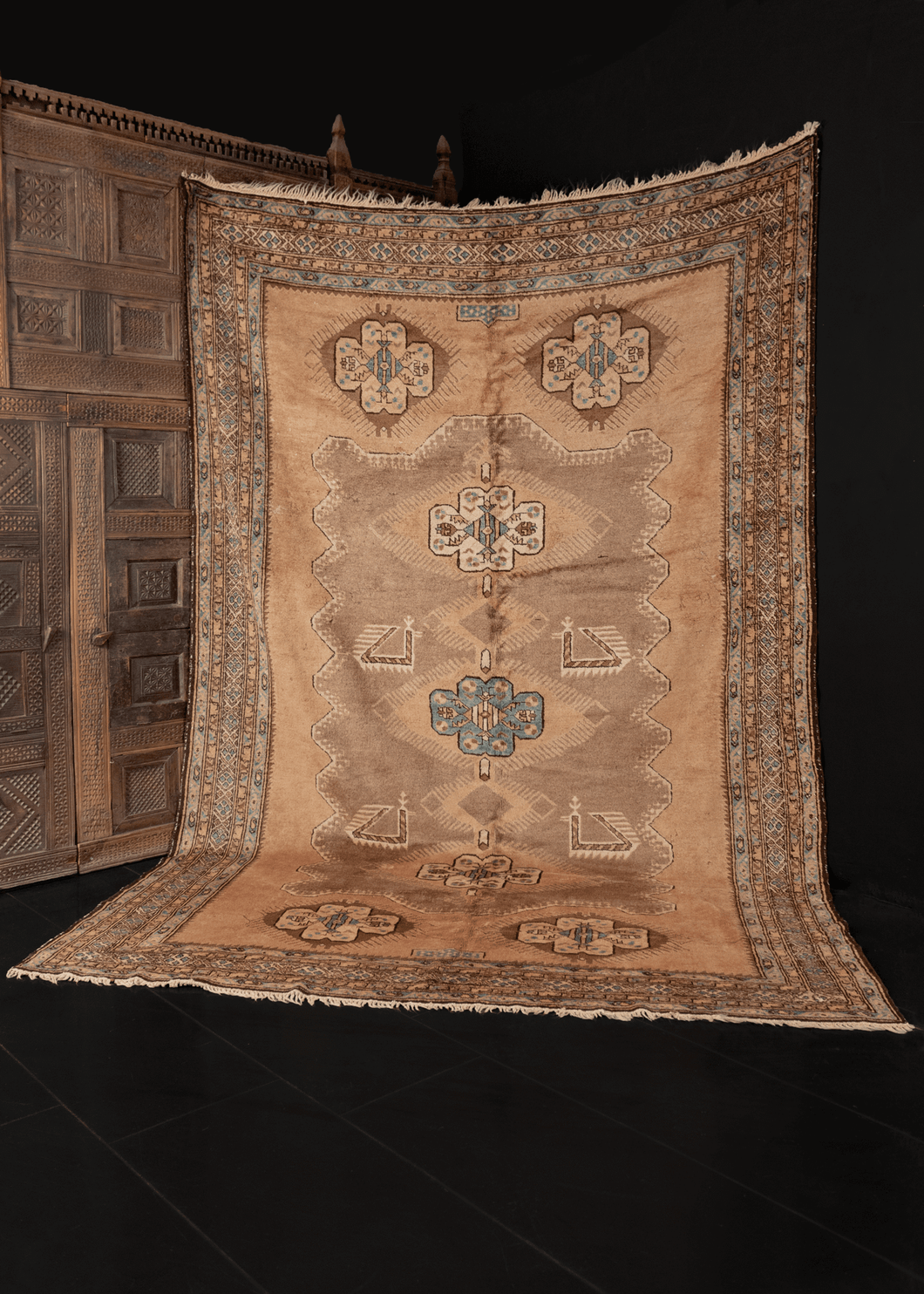 Mid century Caucasian Karabagh rug with a large scale geometric design in golds, browns and blues, with soft silky pile and lustrous sheen