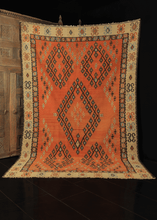 Sarkoy rug with soft brick red field with geometric diamond design