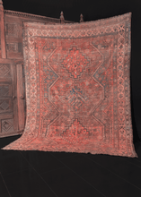 early 20th century khamseh rug from south iran featuring three central medallions. Various shapes and symbols fill in the field. Main colors are bright pink, indigo blue, and natural undyed brown wool. Has some wear but foundation is intact