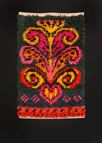 Mid century Rya rug handwoven in Sweden. Bright scroll like symbol in yellow, pink and orange atop forest green field.